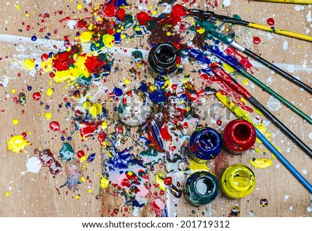 Color bottle and dirty splash on artwork desk - stock photo