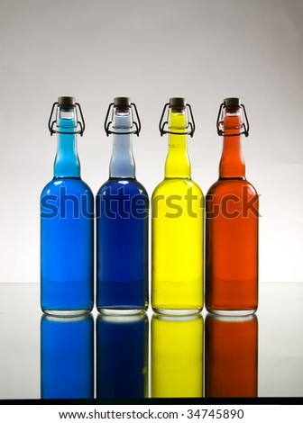 Color Bottles with Deliberate Vignetting - stock photo