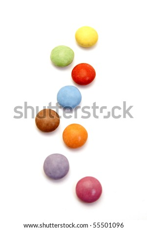 color candies in a row isolated on white - stock photo