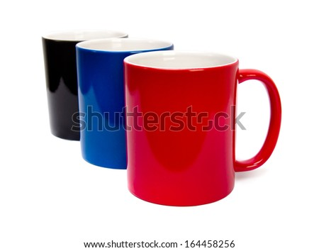 color ceramic cups on a white background - stock photo