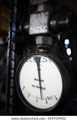 Color close up shot of an old pressure gauge. - stock photo