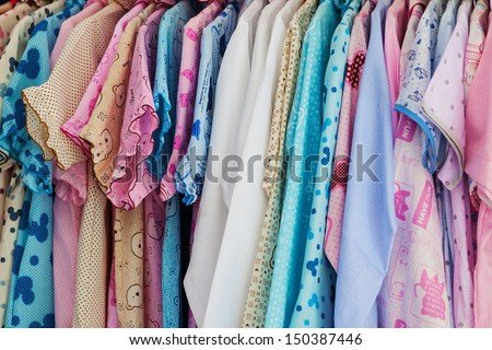 Color clothes hanging on hangers - stock photo