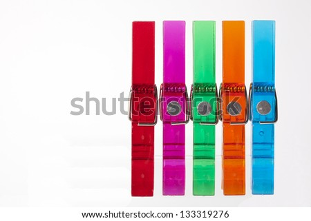 Color clothes-peg isolated on white background - stock photo