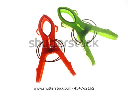 Color clothes pegs on white background - stock photo