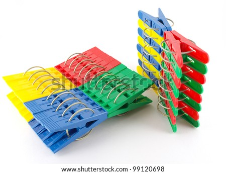 stock-photo-color-clothes-pegs-over-whit