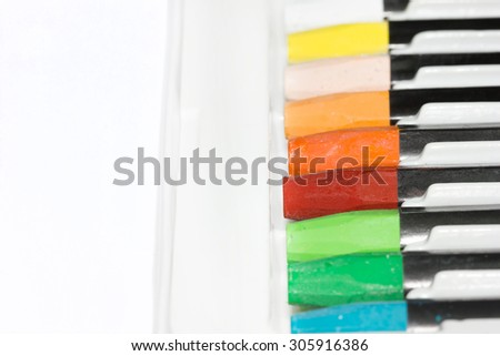 Color Crayons In A Box on white background. - stock photo