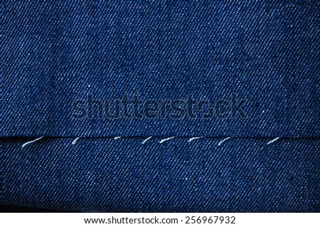 Color Denim Jean Fabric / Concept and Idea of Denim Industry, Sewing and Fashion, Vintage Rustic Style. For Pattern, Background, Wallpaper and Textured. - stock photo