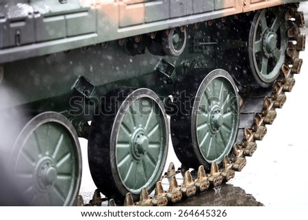 Color detail image of a tank's caterpillar track. - stock photo