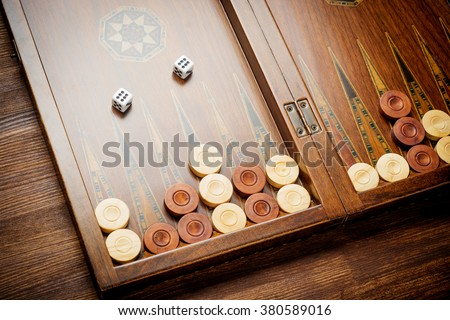Color detail of a Backgammon game with two dice close up. - stock photo