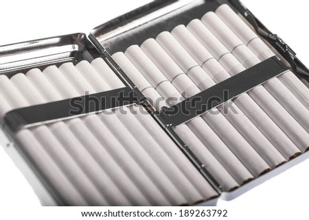 Color detail of a cigarette case with white cigarettes.