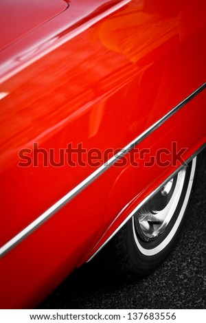 Color detail of the back wheel of a vintage red car - stock photo