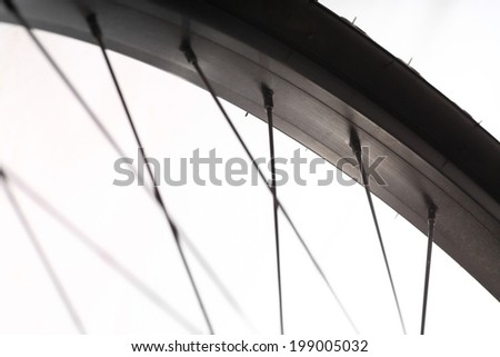 Color detail of the rim of a bicycle wheel, with spokes. - stock photo
