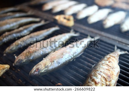 Color detail shot of some fish on a grill. - stock photo