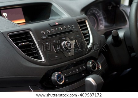 Color detail with the conditioning button inside a car