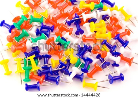 Color drawing pins isolated on white background