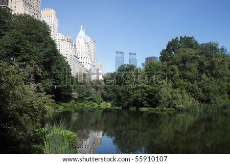 Color DSLR image of Central Park Lake, New York City; in horizontal orientation with the urban skyline and skyscrapers in the background. Copy space for text. - stock photo