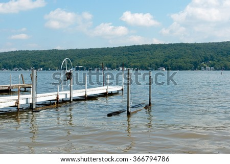 Color DSLR image of empty boat docks on Conesus Lake (a New York Finger Lake); horizontal with copy space for text - stock photo