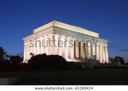 Color DSLR image of the Lincoln Memorial at night with flood lights.  Landmark presidential monument is a popular tourist destination commemorating abolition and end of slavery. Copy space for text. - stock photo