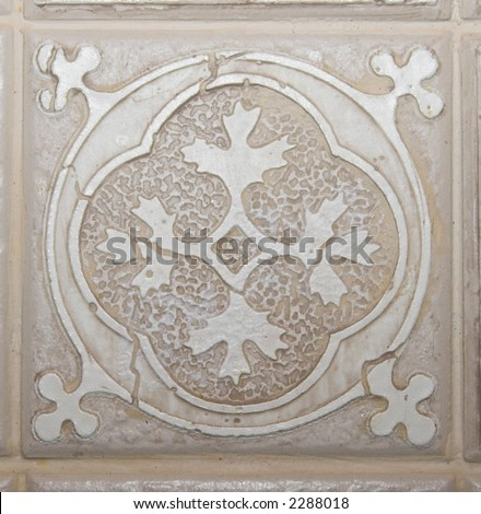 Color DSLR picture of square off white, tan or beige decorative ceramic tile with flower pattern - stock photo