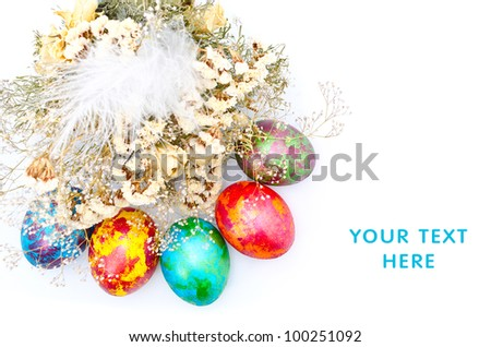 Color Easter eggs with dry flowers isolated on a white background - stock photo