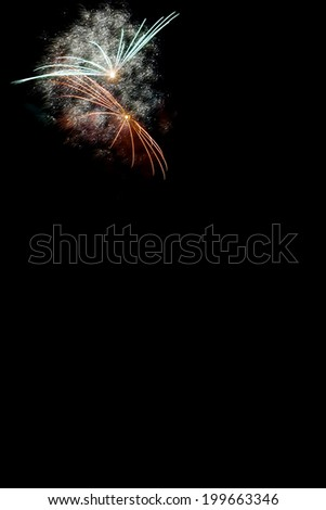 color firecrackers at night - stock photo