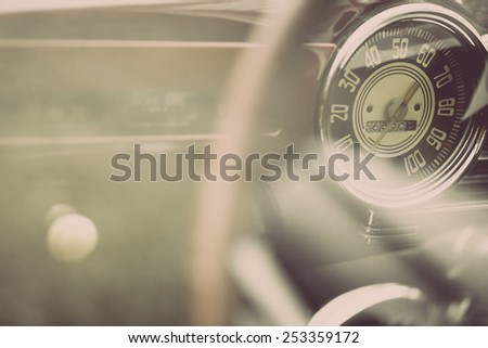 Color horizontal shot of the speedometer of a vintage car. - stock photo