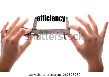 """Color horizontal shot of two hands holding a caliper and measuring the word """"efficiency"""". - stock photo"""