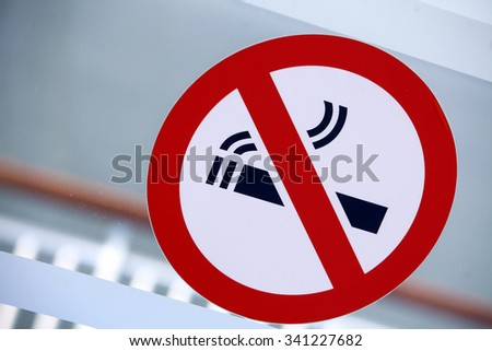 Color image of a 'No Smoking' sign on a window.