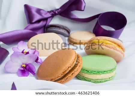 color macaroons on a white background with violet