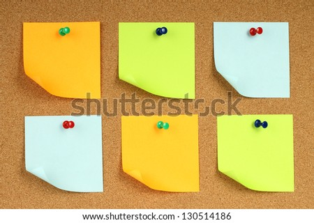 Color notes papers on wooden background - stock photo