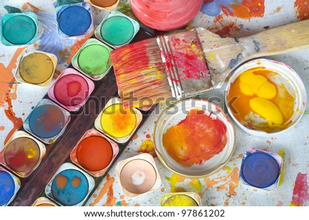 color paint and painting, still life, brushes and paint splatters - stock photo