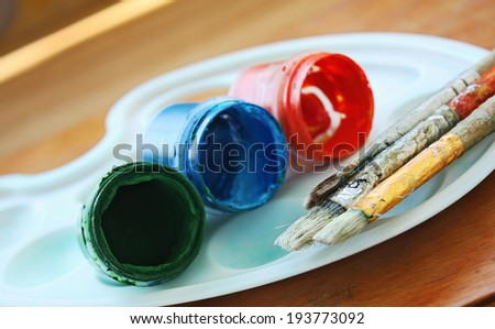 Color paints and brushes - stock photo