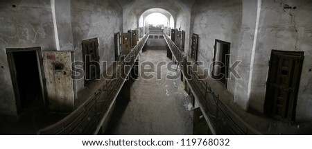Color panorama of an old abandoned prison - stock photo