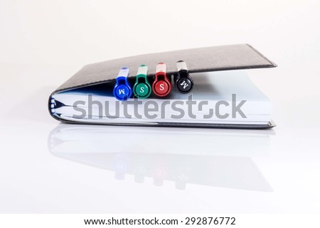 color pen in book - stock photo