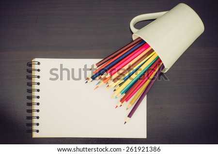 Color pencil and sketchbook on wooden background  - stock photo