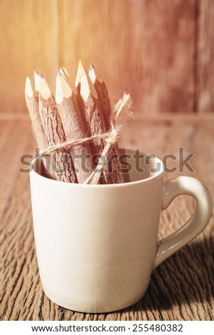 color pencil made of branches in coffee cup : vintage filtered style - stock photo
