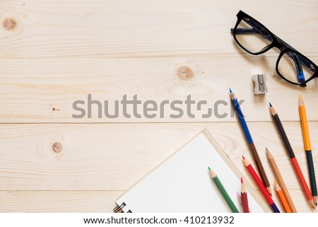 Color Pencil using a sharpener on wodden table, top view with copy space - stock photo