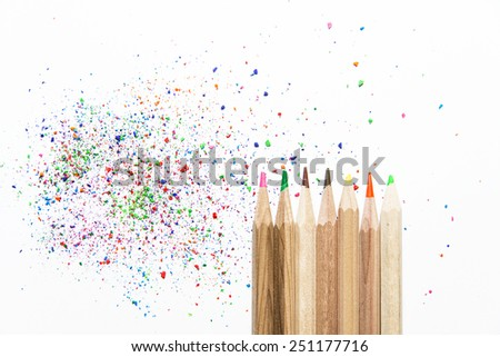 Color pencils and their colorful fragments isolated over white - stock photo