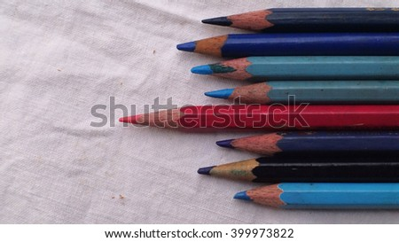 Color Pencils Different - Leading Concept Color Pencils with different one on white background, showing leading concept - stock photo