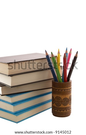 Color pencils in box and books. Isolated on white - stock photo