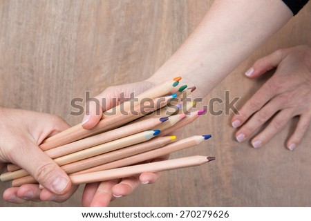 Color pencils in hand