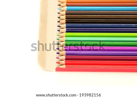 Color pencils in the box with white background