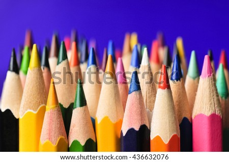 Color pencils isolated on blue background.Close up - stock photo
