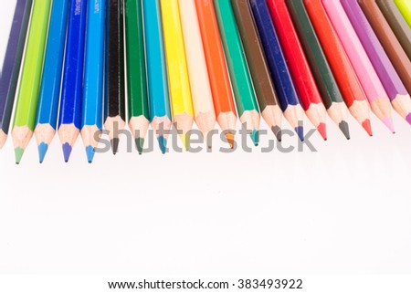 Color pencils of various color on a white background