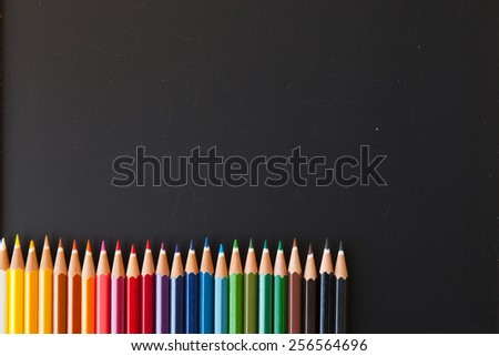 Color pencils on blackboard