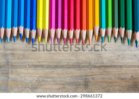 Color pencils on wood background close up ,Color pencils Background texture - stock photo