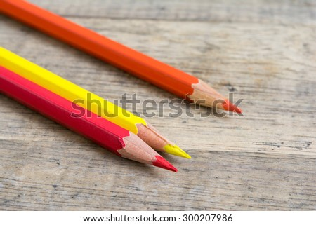 Color pencils on wood background close up ,Color pencils Background texture ,Color pencils red mix yellow to orange color,primary color - stock photo