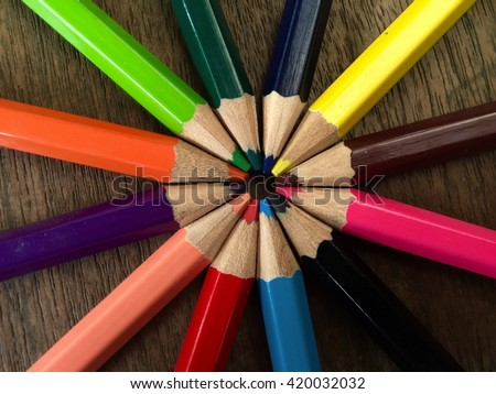 Color pencils on wooden background - stock photo