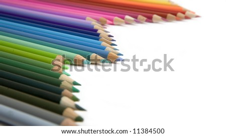 color pencils over white background