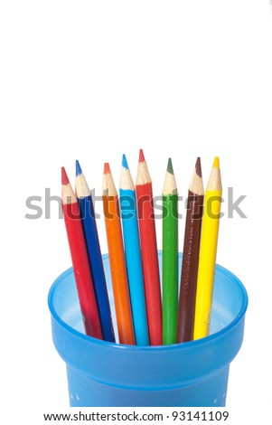 Color pencils spread out in cup. - stock photo